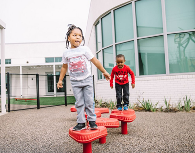 Play structures are visible from surrounding classrooms, secured into soft-land, rubber surfaces and feature the most up-to-date safety standards.